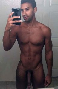 Black cam dude poses naked